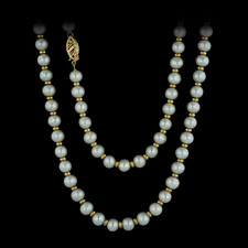 This opera length pearl strand to measure 30 inches, features alternating 6 mm pearls, and 3.25 mm 14kt yellow gold discs. The piece is finished with a beautiful yellow gold clasp.