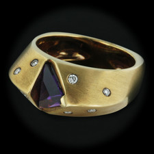 This is a 18kt yellow gold amethyst Hollander ring.This piece also has 8 diamonds The size is 6.5 and band is 5mm thick.