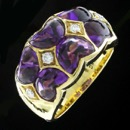 This is a gorgeous 18kt yellow gold Winc creations fashion ring. That includes 6 heart shaped amethyst and 4 beautiful diamonds .12ct tw.. The size is 6.5 and is 11.5mm in width.