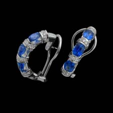 These classic semi-circle earrings feature 2.83cts. in blue sapphires and .38cts. in diamonds.