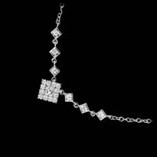 A classic diamond princess necklace.  This delicate design is set with .33ctw of diamonds. The necklace is in 18kt white gold and is 16 inches in length. The cluster measures 6.8mm.