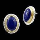 A pari of Gurhan Earrings. Made in silver and gold, clips+post. The center stone is a lapis and has a size of the earrings are 18x13.