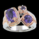 A lovely three stone Amethyst sterling silver and 18K gold ring from Bellarri. The Amethyst weighs 2.50tcw. and is surrounding with diamonds, at a total carat weight of 0.17. The head of the ring have Dimensions of: 18mm x 14mm