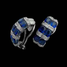 These beautiful 18k white gold huggy earrings are striped with 4.75cts. in sapphires and .65cts. in diamonds.