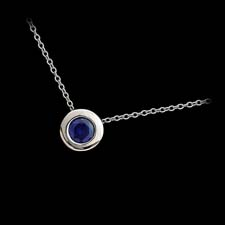 Our classic bezel set sapphire pendant in 18kt white gold.  This 4.7mm .45ct sapphire is the finest color available and is a very intense blue. Eat your heart out Tiffany & Co.