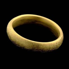 A 5.5mm 18kt yellow gold ring by Christian Bauer. Available in fiberglass finish, rock finish or bright polish.