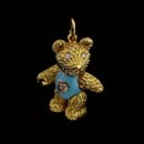 A very cute 18kt gold enamel and diamond bear charm. This piece is 7/8 inches in length. A larger piece available in 1 1/8th inches for $3,970.00.  Pink and blue real fired enamel is available.  Head, arms, and legs move. Made in the USA