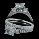 Palladium .32ctw pave diamond engagement mounting from Scott Kay. This price does not include the center stone. Matching w'd band set with .24ct. Diamonds are VS F-G quality. Center CZ is a 6mm. Set is size 6 1/2. This is new old stock. Sold as a set only but what a buy!!