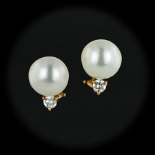 161CO2 - These South Sea Pearl earrings are so beautiful.  The pearls measure 11mm each and are accented with full cut round brilliant diamonds with a total diamond weight of .50ct. The earrings are done in 18kt yellow gold with an omega back to hold them in place perfectly.