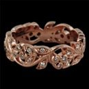 An 18k Rose gold diamond eternity wedding band from Beverley K. This ring has a beautiful floral design with bezel set diamonds that are placed in clusters and has a total diamond weight of .40ct. and 5.8mm wide.