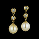 These beautiful South Sea pearls measure 9.5mm in diameter and are suspended in an 18kt yellow gold setting with two bezel set diamonds in each earring.  There is a total diamond weight of .32ct. The earrings dangle 1 inch in length.