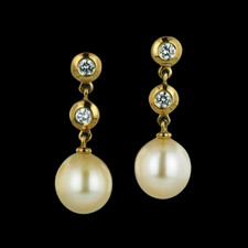 166CO2 - These beautiful South Sea pearls measure 9.5mm in diameter and are suspended in an 18kt yellow gold setting with two bezel set diamonds in each earring.  There is a total diamond weight of .32ct. The earrings dangle 1 inch in length.