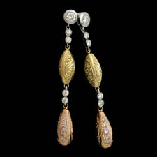 A gorgeous set of platinum, rose gold and yellow gold earrings handmade by Beaudry.  The pair is set with 1.62ctw of white, pink, and canary diamonds. Engraving is beautiful. Call for price and availability.