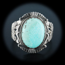 A gorgeous sterling silver motif design bracelet. This 1960's era vintage piece has a single large light blue turquoise stone in the center measuring 1 3/4