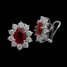 These gorgeous platinum earrings from the Pearlman's Collection feature 4.65cts. in red rubies framed by 2.77cts. in diamonds.