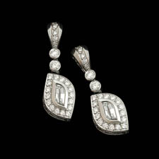A hot pair of handmade platinum earrings by Beaudry. The set contains .37ctw of