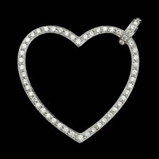 A 18kt white gold diamond heart pendant set with 55 diamonds weighing .74ct total. VS G-H