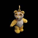 a very cute 18kt whit and yellow gold sapphire eye eddy bear char. This very heavy piece measures 7/8'' in length. Available in 1  1/8'' for $3,600.00 Arms, head, and legs move.  Made in the USA