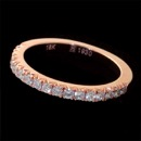 The finest mini prong diamond band made. This piece is 18kt rose gold and set with .35ct of ideal cut VS+ F-G quality diamonds. Look closely and see the craftsmanship. This is the step down version diamond set 1/2 way around the ring and available in 18kt gold and platinum. Handmade in the USA.