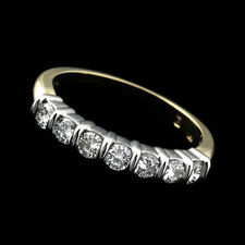 Alexander Primak platinum and 18k yellow gold wedding band set with .50ctw in full-cut round diamonds.