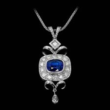 This antique-inspired platinum pendant by Michael Beaudry features an intricate bezel and a 2.82ct. cushion-cut tanzanite with a briolette drop. Call for price and availability.