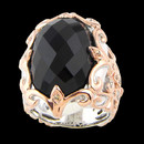 Sterling silver and 18K gold black onyx ring from Bellarri. There are diamonds surrounding the onyx. The size of the black onyx 16.10tcw. and the total diamond weight is 0.06tcw. The size of the head of the ring is: 27mm x 21mm. This ring has a beautiful checkerboard cut.