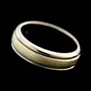 "18kt yellow, red, and gray gold blend with sterling silver in George Sawyer's ""F"" color palette. This ring measures 7mm in width with gray gold edges."
