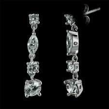 A stunning set of hand made 18kt white gold drop dangle earrings.  The pair are set with 2.0ct of fine VS-F-G ideal cut diamonds. Each earring measures 24mm in length.  Very pretty!!!