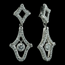 An exquisite pair of diamond and platinum earrings from Michael B.  Intricate design made up of 182 pave set diamonds and 2 round bezel set diamonds in the center that are .25ctw.