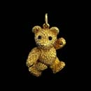 Adorable 18kt gold bear with blue sapphire eyes. This piece measures 7/8 inches and is solid. Available in 1 1/8th inch size for $3,800.00. Arms, legs, and head move.  Made in the USA