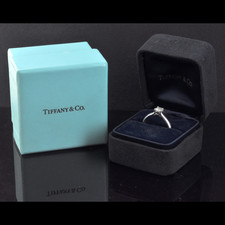 190PO1 - A ladies platinum Tiffany and Co engagement ring. The ring, size 6, contains one certified .40ct G VVS1 Lucinda cut diamond.  The ring is in excellent condition complete with boc and papers. Tiffany retail $3,690.00