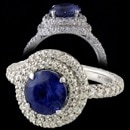 A almost new 90% platinum Michael B diamond and sapphire ring.  The ring is set with a total of 1.0ct of micro pave set diamonds of E color and VVS clarity.  All diamonds are ideal cuts.  The diamonds on the shank go all of the way around the ring.  Set in the center is a GIA certified unheated 2.79ct round sapphire of a beautiful rich blue color (see report)  The ring is a size 5 3/4 and measures 13.5mm at the rings top. Shank measures 2.5mm.  The shank has pave diamonds on all three sides.  Sapphires has slight abrasions on the table edge This is a really wonderful ring.