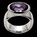 A bold look by Bastian Inverun. The ring has a high polished finish and is bezel set with an oval faceted amethyst. The amethyst weighs 5.20 carats.