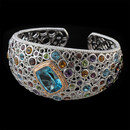 A true work of art, this multi gemstone bracelet from Bellarri is from the Madam B collection. This bracelet is made of sterling silver and has 18k gold around the center blue topaz. The center blue topaz has a total carat weight of 13.35; it is surrounded by a halo of diamonds that weigh 0.22 and are on top of 18K gold. The height of the bracelet is 33mm. A wonderful piece of Bellarri jewelry.