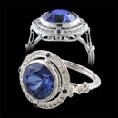 A truly stunning 18K antique style ladies Beverley K engagement ring. The center blue sapphire is bezel set and surrounded by a gorgeous sapphire and diamond halo. There is a diamond shaped design underneath the center stone. A vintage art deco inspired design. This ring is also available in platinum. The center stone can be anything you would like; just image a diamond instead of a sapphire. Like with all Beverley K pieces; this ring can be made is yellow and rose gold. A stunning work of art that captures the art deco design period, the photos do not do the ring justice.