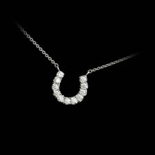 A 18kt white gold horse shoe diamond necklace set with 11 diamonds weighing .36ct.  VS G-H diamonds.