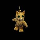 A adorable 18kt. gold movable kitten with natural emerald eyes. The arms, legs, and head move! This is the 1 1/8 inch piece.  Also can be ordered in a small size 7/8 inch. The finest one made. Very solid and heavy. Made in the USA