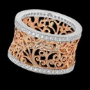 A pretty 18k gold and floral wedding band from Beverley K. There are diamonds on the top and bottom of the frame that have a total carat weight of 0.56tcw. The mid section of the ring features am intricate rose gold floral design that has milgrain etching, but can be made without the milgrain. This is a wonderful floral band that could be a combined engagement ring and wedding band set on its own.