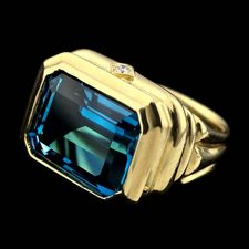 Ladies 18kt. green gold SeidenGang ring set with a 13mmx15mm swiss blue topaz and accented with .06ctw in diamonds.