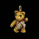 Beautiful 18kt gold emerald and diamond teddy bear charm. This piece measures 7/8th inches. Available in 1 1/8 inches for $5,600.00  Arms, legs and head move. Made in the USA.  Very solid piece.