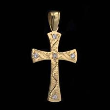 18kt yellow gold diamond set engraved cross with .18ctw of diamonds.