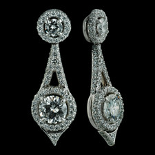 Elegant and sophicated platinum Pendulum earrings from Michael B.  The top prong set diamonds are .36ctw and are surrounded by a delicate pave halo. The intricate design of the pendulum is covered in pave diamonds that circle around 2 larger prong set diamonds that are 1.52ctw.