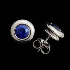 Our classic bezel set sapphire earring in platinum.  This is the finest sapphire available and are very intense blue. .70ct. Eat your heart out Tiffany & Co.