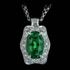 This Jane Taylor necklace features a beautiful 2.44ct tsavorite garnet surrounded by .25ctw diamonds in 18kt white gold on a 16