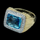 From the Facete collection by Spark an 18 karat gold two tone ring. The ring is set with 0.26 carat in diamonds and a 7.00 carat blue topaz.