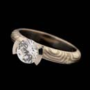 An exotic 14kt grey gold and sterling silver diamond engagement ring by George Sawyer. The curved channel is platinum. This ring is 3.6mm in width. Also available in different widths and metal combinations. Call for pricing on these different options. Center diamond not included in pricing.