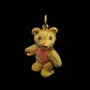 A very cute 18k gold bear with pink sapphire eyes, a diamond heart, with pink enamel tummy. This piece is 7/8 inches.  Arms, legs, and head are movable.  Solid piece! Made in the USA.