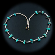 A gorgeous beaded vintage necklace with fifteen turquoise stones. The piece measures 24