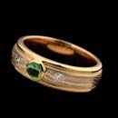 Designed by George Sawyer, a beautiful tsavorite, garnet and diamond band.  The ring is 6mm in width and made of 18kt red gold with 14kt grey gold and sterling silver.