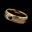 George Sawyer's beautiful 6mm sapphire and diamond ring.  The piece is made of 18kt yellow gold, grey gold, rose gold and sterling silver.